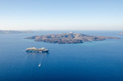 Cruise liner Mein Schiff 2 between Santorini and Nea Kameni Royalty Free Stock Photos