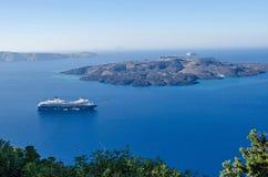 Cruise liner Mein Schiff 2 between Santorini and Nea Kameni Stock Images