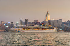 Cruise Liner moored along side Kong Kong Financial district Stock Images
