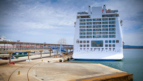 Cruise liner moored in a seaport Stock Images