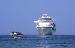 Cruise liner and motoboat in port Royalty Free Stock Photography
