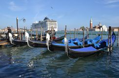 Cruise liner moving away from Venice lagoon in Easter sunny day. Royalty Free Stock Photography