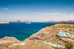 Cruise liner near the Greek Islands. Bright turquoise sea and blue sky. Santorini island, Greece Stock Images