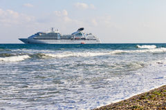 Cruise liner near to the seacoast. Cruise liner near to the beach in Nessebar Bulgaria Stock Photo