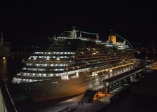Cruise liner at night in the port of Palma de Mallorca stock photography