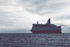 Cruise liner in open sea. Passenger ferry sailing at hot sunset Royalty Free Stock Photography