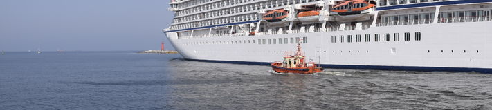 Cruise liner panorama. Cruise liner leaving port in Gdansk Stock Photo