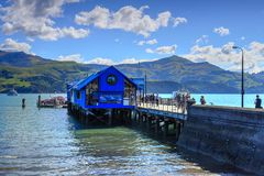 Main Wharf, Akaroa, New Zealand. Passengers walking to tender royalty free stock image