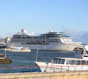 Cruise liner into port area. Big cruise liner into small port area Royalty Free Stock Image