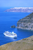 Cruise liner at Santorini Island, Greece. Santorini island, Oia town, cruise liner and rocks Stock Photography