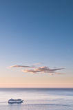 Cruise liner at sea. Cruise liner and dawn skyscape (portrait Stock Photography