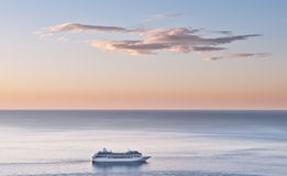 Cruise liner at sea. Cruise liner and dawn skyscape (landscape Royalty Free Stock Photos