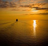 Cruise liner in the sea at sunset Royalty Free Stock Photos