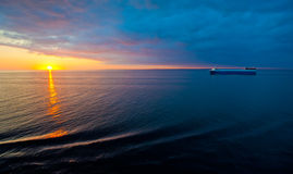 Cruise liner in the sea at sunset Stock Photography