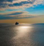 Cruise liner in the sea at sunset. Big cruise liner in the sea at sunset Royalty Free Stock Images