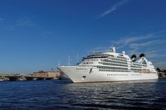 Cruise liner Seabourn Quest departs from St. Petersburg, Russia. St. Petersburg, Russia - August 5, 2015: Cruise liner Seabourn Quest departs from the Neva river Royalty Free Stock Photos