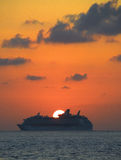 Cruise liner and setting sun Stock Photos