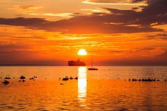 Cruise liner ship in sunset in sea Stock Photos