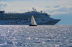 Cruise liner and a small yacht Stock Image