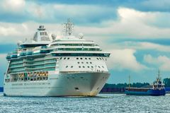 Cruise liner at summer. White cruise liner moving to the sea at cloudy day Stock Images
