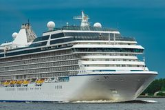 Cruise liner at summer. White cruise liner moving to the sea at cloudy day Royalty Free Stock Photography