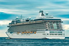 Cruise liner at summer. White cruise liner moving to the sea at cloudy day Royalty Free Stock Image
