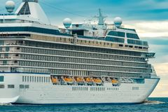 Cruise liner at summer. White cruise liner moving to the sea at cloudy day Royalty Free Stock Photos