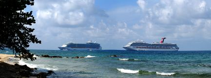 Cruise Liners. Panoramic view of two cruise liners from Seven Mile Beach on Grand Cayman Island, British Virgin Islands Royalty Free Stock Images