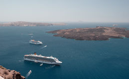 Cruise liners at anchor in the Santorini lagoon. Royalty Free Stock Photography