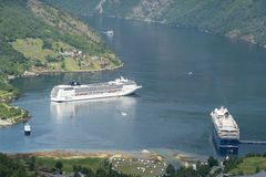 Cruise liners in Geirangerfjord sea port with tourists on June 29, 2016 in Geiranger, Norway. Stock Images