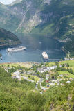 Cruise liners in Geirangerfjord sea port with tourists on June 29, 2016 in Geiranger, Norway. Royalty Free Stock Photo