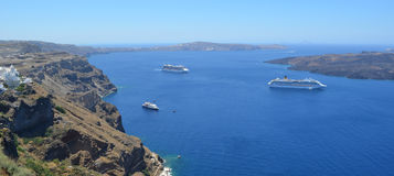 Cruise liners moored in the caldera visitng Santorini. Royalty Free Stock Photography