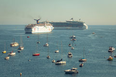 Cruise liners and sailboats Stock Photography
