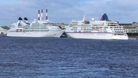 Cruise liners `Seabourn Quest` and `Europa` on Neva river stock video