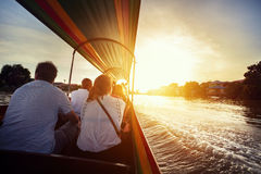 Cruise on long tail Boat in Thailand. Tourist sitting in long-tail boat cruise by Chao Phraya river in Ancient city Ayutthaya at Sunset, Thailand Royalty Free Stock Image