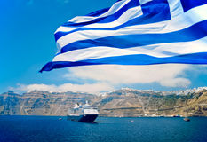 Cruise in the Mediterranean Sea. Greek Flag in the Front of the Coastline of Santorin Stock Image