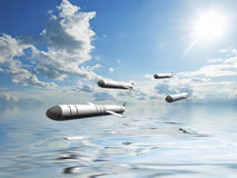 Cruise missiles flying against the clouds Stock Photo