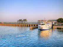 Cruise on Nile. Touristic cruise crossing Esna bridge, Egypt Royalty Free Stock Photography