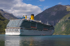 Cruise in Norway. Large cruising ship in a Norwegian fjord Stock Image