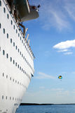 Cruise Parasail. Cruise ship on the blue ocean with a parasail in the sky in the background Royalty Free Stock Image