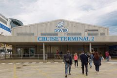 Cruise passengers outside the Dover Cruise Terminal, UK. Cruise Terminal, Port of Dover, Kent, England. A group of cruise passengers return to the Terminal Stock Photography