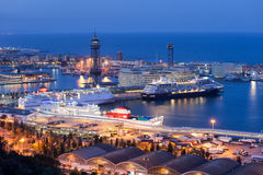 Cruise Port Terminal in Barcelona at Night. City of Barcelona at night in Catalonia, Spain. Ships docked at cruise port terminal Moll Adossat, water of Stock Photo