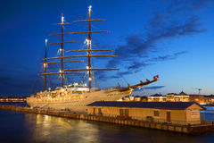 Cruise sailing ship Sea Cloud II the English wharf summer night. St. Petersburg Stock Photos