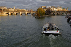 Cruise on Seine River. PARIS, FRANCE, January 26, 2016 : Cruise on Seine River at dusk Royalty Free Stock Images