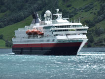 Cruise ship. Big, luxurious passenger ferry in a Norwegian fjord Stock Photography