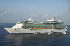 Cruise Ship. A large cruise ship pulling into a tropical harbor Stock Image