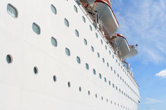 Cruise Ship. Large luxury cruise ship with portholes and lifeboats Stock Photo
