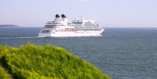 Cruise Ship. In Finland Gulf with yellow flowers in the foreground, Suomenlinna Sveaborg Helsinki stock photography