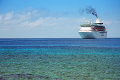 Cruise ship. Huge cruise ship in tropical waters Stock Images