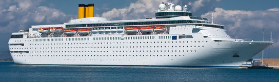 Cruise ship. Luxury white cruise ship shot with calm sea and blue sky with some clouds Stock Photography
